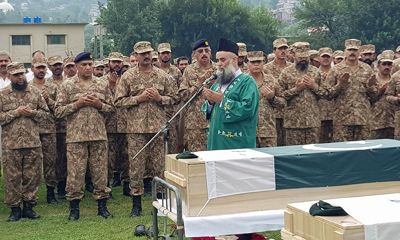 Army personnel and civilians offer funeral prayers of Naik Tanveer, Lance Naik Taimoor and Sepoy Ramzan at Neelum stadium, Muzaffarabad, AJK on Friday. — Photo courtesy Tariq Naqash