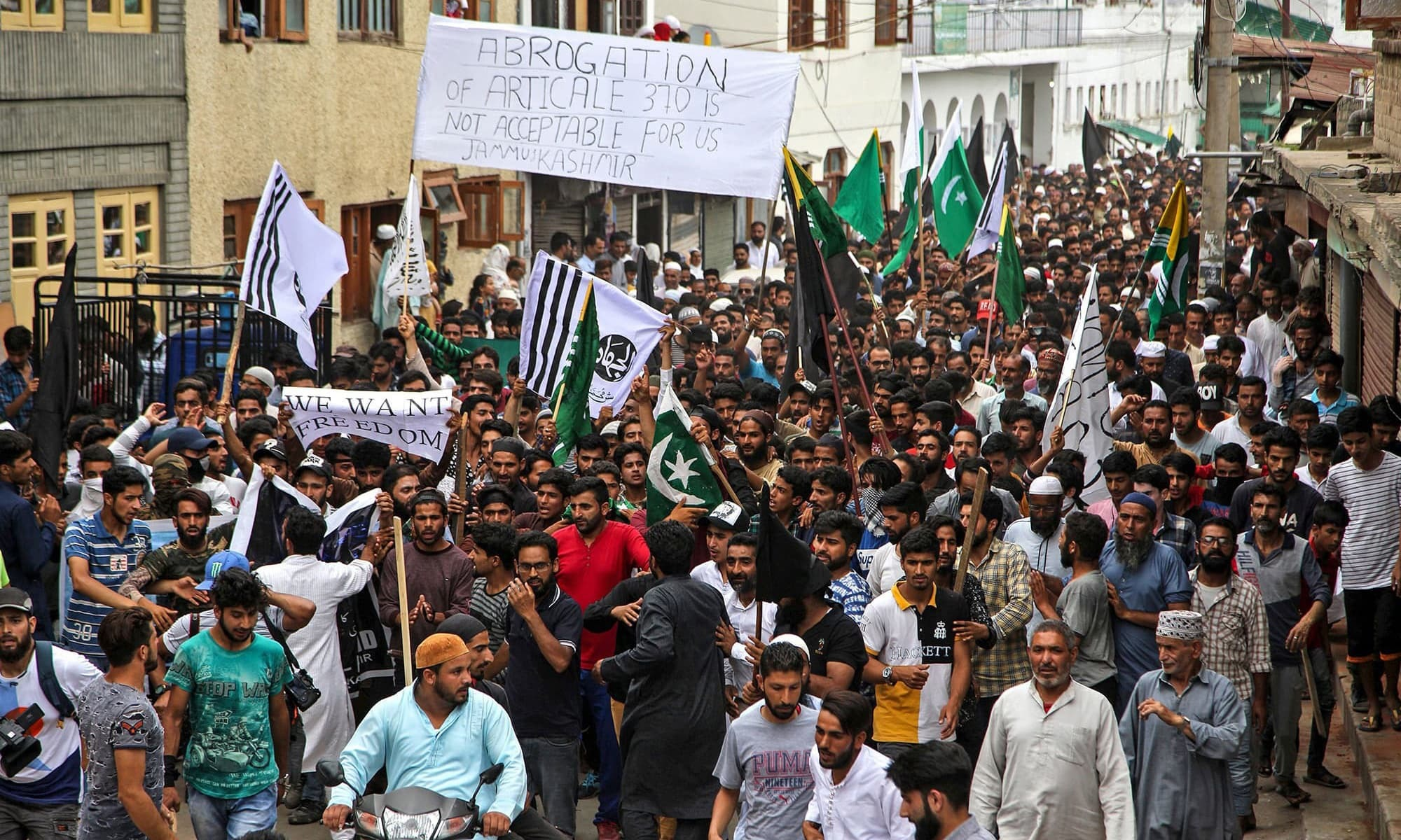 In this photo taken on August 9, Kashmiri Muslims shout pro-freedom slogans during a protest in Srinagar. — AFP