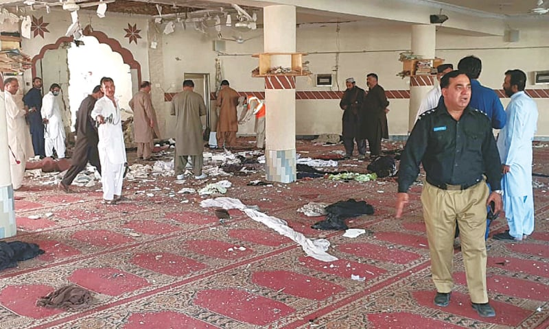 QUETTA: Security personnel inspecting the mosque hall inside a madressah at Kuchlak, where the bomb blast took place on Friday.—Online