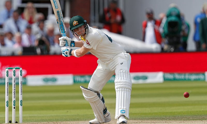 Australia's Steve Smith plays a shot for four runs to reach his half-century during play on the fourth day of the second Ashes cricket Test match between England and Australia at Lord's Cricket Ground in London on Saturday. — AFP