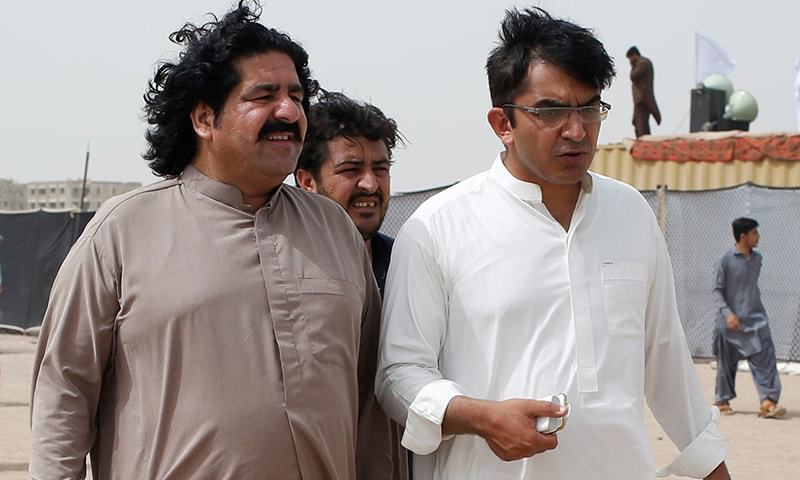 Ali Wazir (L) and Mohsin Dawar, leaders of the Pashtun Tahaffuz Movement (PTM), walk at the venue of a rally  in Karachi, May 13, 2018. — Reuters/File