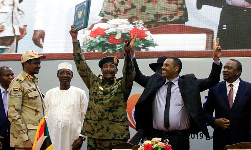 Sudan's Head of Transitional Military Council, Lieutenant General Abdel Fattah Al-Burhan, and Sudan's opposition alliance coalition's leader Ahmad al-Rabiah, celebrate the signing of the power sharing deal, that paves the way for a transitional government, and eventual elections, following the overthrow of long-time leader Omar al-Bashir, in Khartoum, Sudan, on Saturday. — Reuters