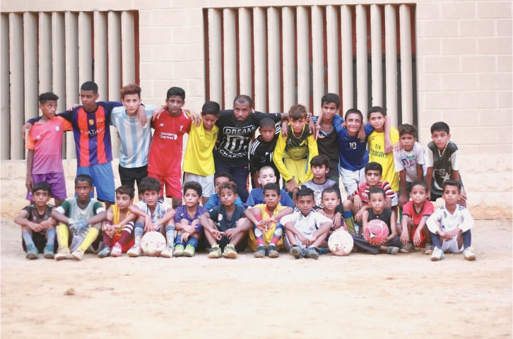 Coach Murad and his young footballers