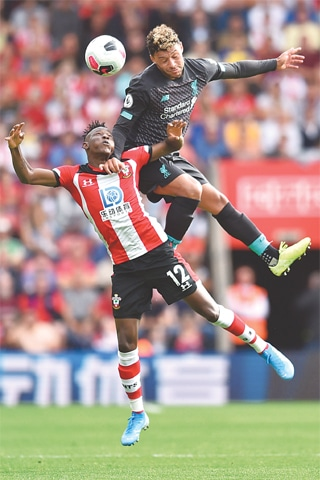 SOUTHAMPTON: Southampton's Moussa Djenepo (L) vies for the ball with Liverpool's Alex Oxlade-Chamberlain during the English Premier League match at St Mary's Stadium on Saturday.—AFP