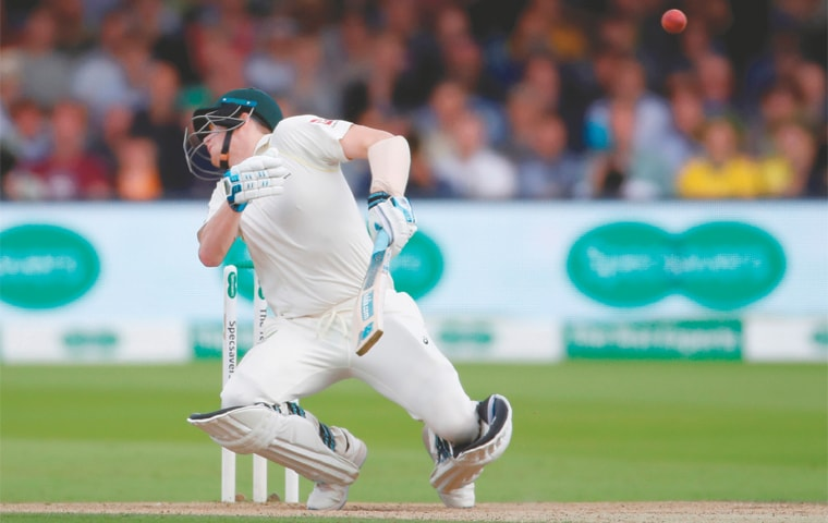 LONDON: Australian batsman Steve Smith is hit on the neck by a bouncer from England fast bowler Jofra Archer  (not in picture) during the second Test at Lord's on Saturday.—Reuters