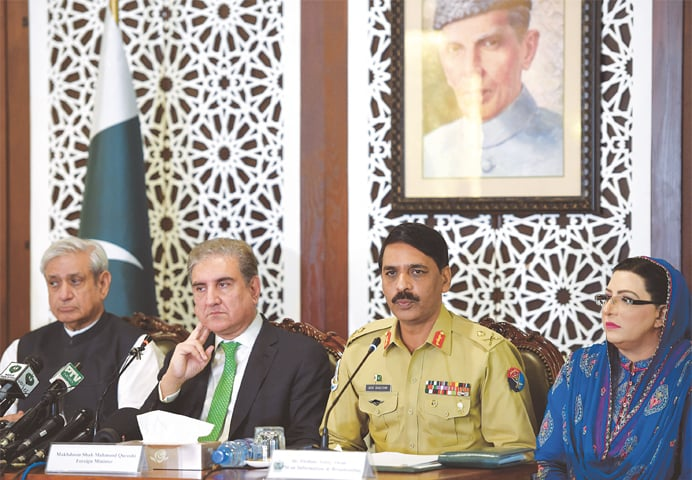 ISLAMABAD: (from left) Chairman of the Parliamentary Kashmir Committee Fakhar Imam, Foreign Minister Shah Mehmood Qureshi, director general of the ISPR Maj Gen Asif Ghafoor and Special Assistant to the PM Firdous Ashiq Awan addressing a press conference at the foreign ministry on Saturday.—Tanveer Shahzad / White Star