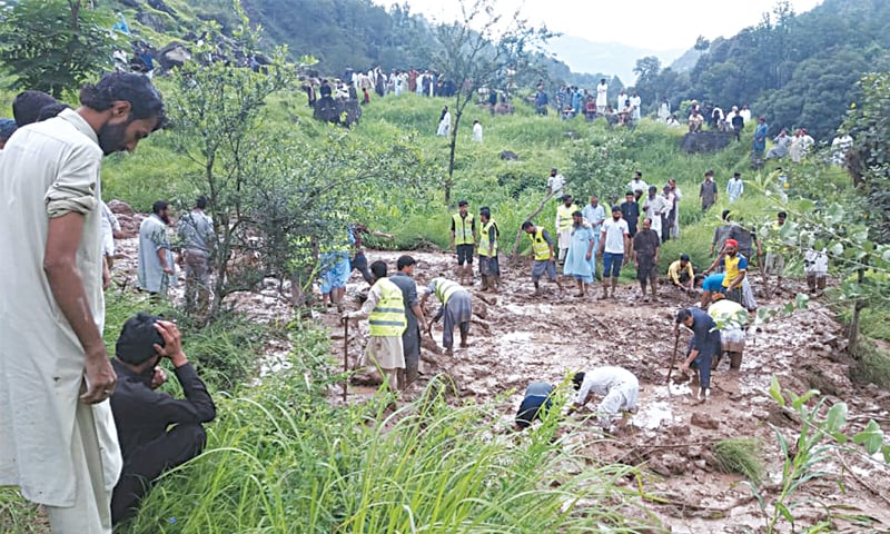 Rescue teams search for bodies of landslide victims in Poonch district of AJK.—Photo by writer