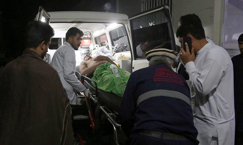 A wounded man is carried to a hospital after an explosion at wedding hall in Kabul, Afghanistan, on Sunday. — AP