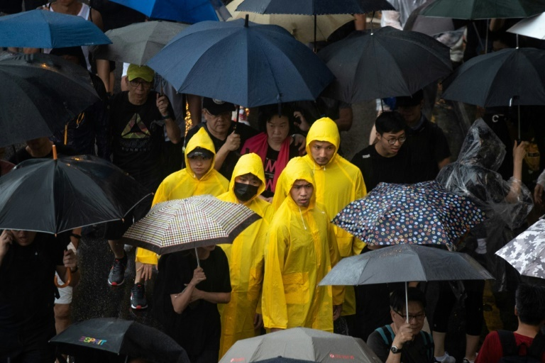 Protesters flouted a police order not to march from the park, pouring across the heart of Hong Kong island despite torrential rain. ─ AFP