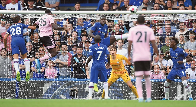 LONDON: Leicester City's Wilfred Ndidi (second L) jumps to score during the English Premier League match against Chelsea at Stamford Bridge on Sunday.—AFP
