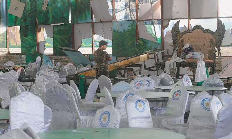 KABUL: An Afghan soldier inspects the damaged wedding hall after the explosion.—AP