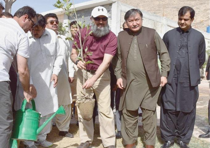 QUETTA: Balochistan Chief Minister Jam Kamal Khan Alyani kicks off tree plantation campaign on Sunday.—Dawn