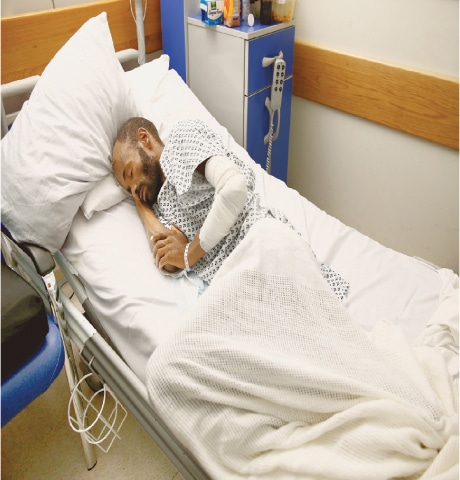 TAL QROQQ (Malta): Mohammed Adam Oga, an Ethiopian migrant and the lone survivor of an 11-day journey across the Mediterranean, takes a nap in his hospital bed.—Reuters
