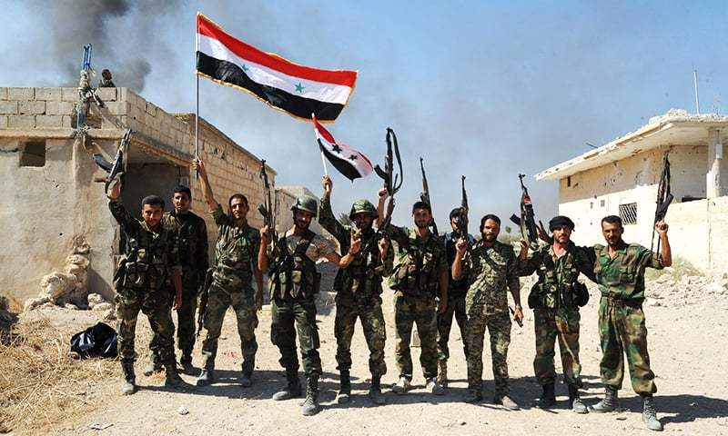 In this file photo, released by the official Syrian Arab News Agency (SANA), shows Syrian army units and pro-government forces deploying at an undisclosed location in the Atshan village in central province of Hama,  on October 11, 2015. Regime forces advanced in the central Syrian province of Hama against armed opposition groups in a ground operation backed by Russian air strikes. — AFP Photo/ HO / SANA