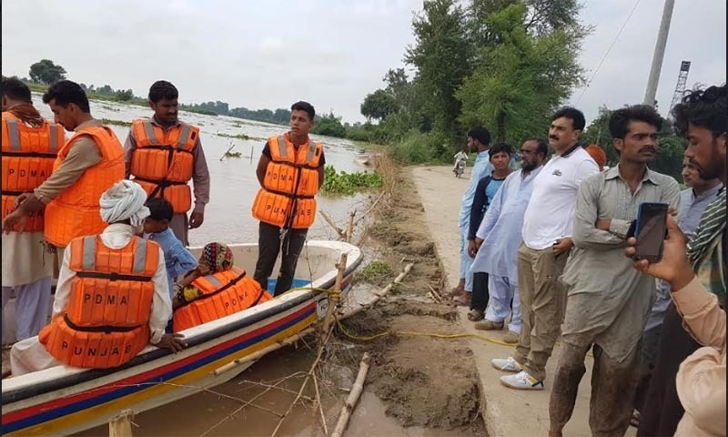 Flood evacuation and sensitisation efforts underway by the Kasur district administration. — Photo by Muhammad Taimoor