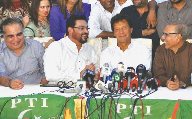 Imran Khan, new entrant Aamir Liaquat and other PTI leaders are all smiles at a press conference.—PP