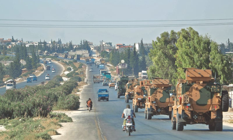 IDLIB: A convoy of Turkish military vehicles passes through the town of Saraqeb, in Syria's north-western province of Idlib. —AFP