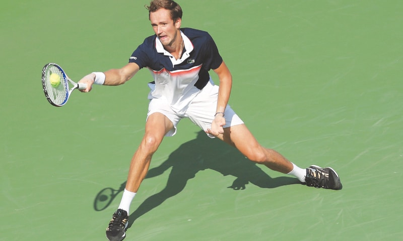 CINCINNATI: Daniil Medvedev of Russia hits a return to Belgium's David Goffin during final of the Cincinnati Masters.—AFP