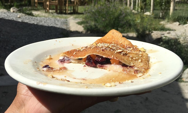 Crepes with apricots and cherries, coconut cream, maple syrup and almonds to start off the day.