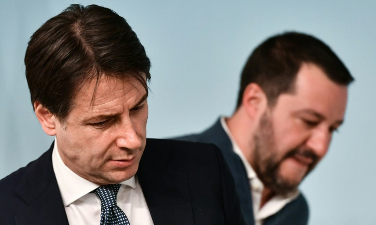 Giuseppe Conte (L) was due to speak in the Senate following a week of fallout from the dramatic decision by Matteo Salvini (R) to back out of the alliance. ─ AFP