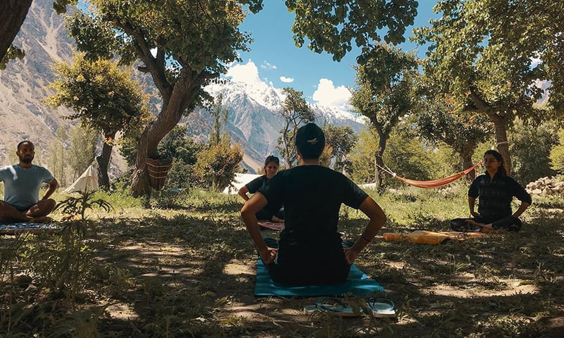 A yoga class in the mountains.