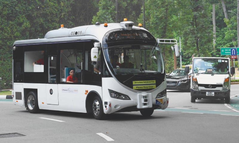 AN on-demand autonomous shuttle bus plies the road during a trial run at Sentosa island resort in Singapore. — AFP