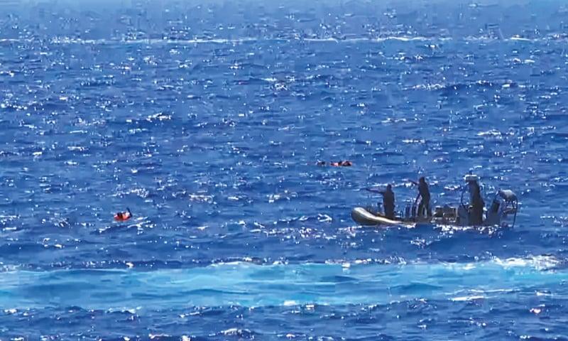 Desperate migrants jump off rescue ship to reach Italy's shores
