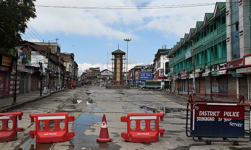 In this file photo taken on August 19, the clock tower at deserted Lal Chowk is pictured during a security lockdown in Srinagar, occupied Kashmir. — AFP