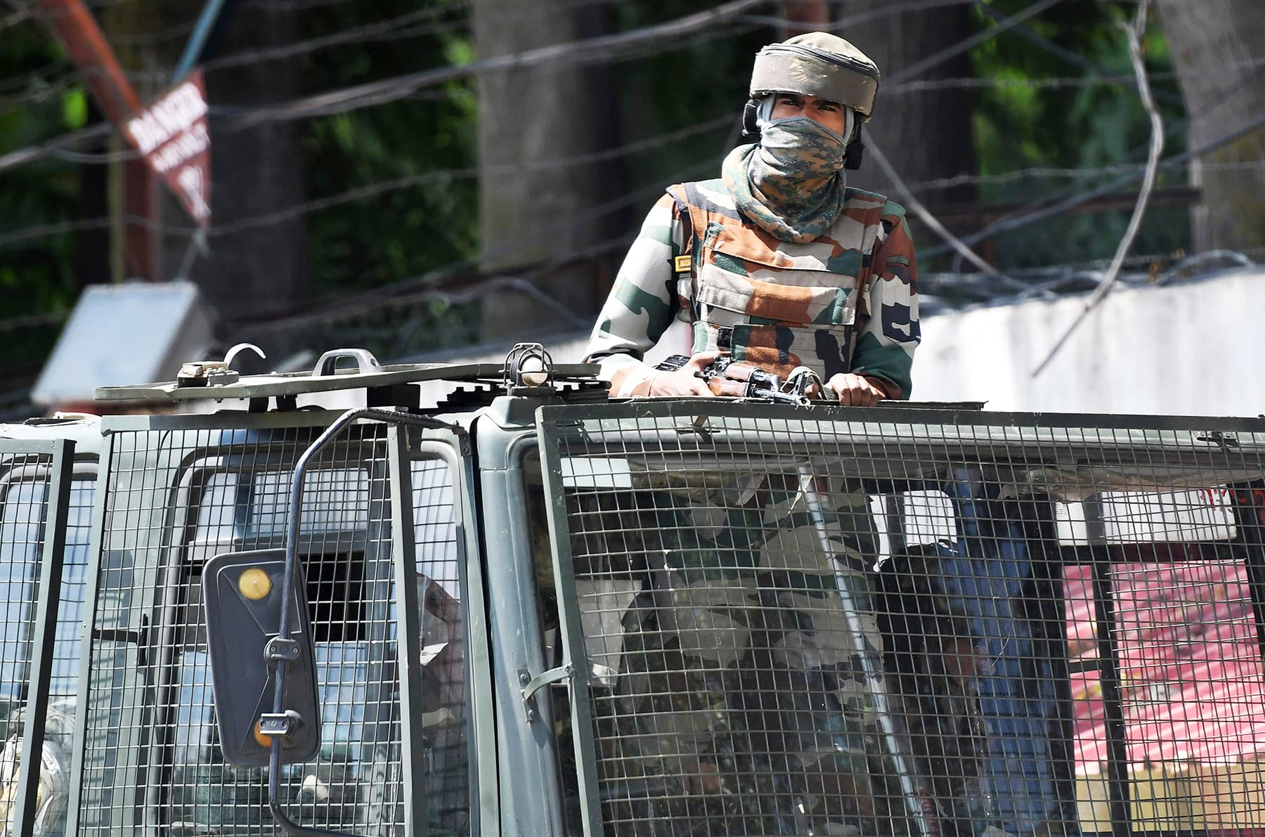 In this photo taken on August 18, an Indian army soldier stands alert in a truck while travelling in a convoy in Srinagar. —AFP