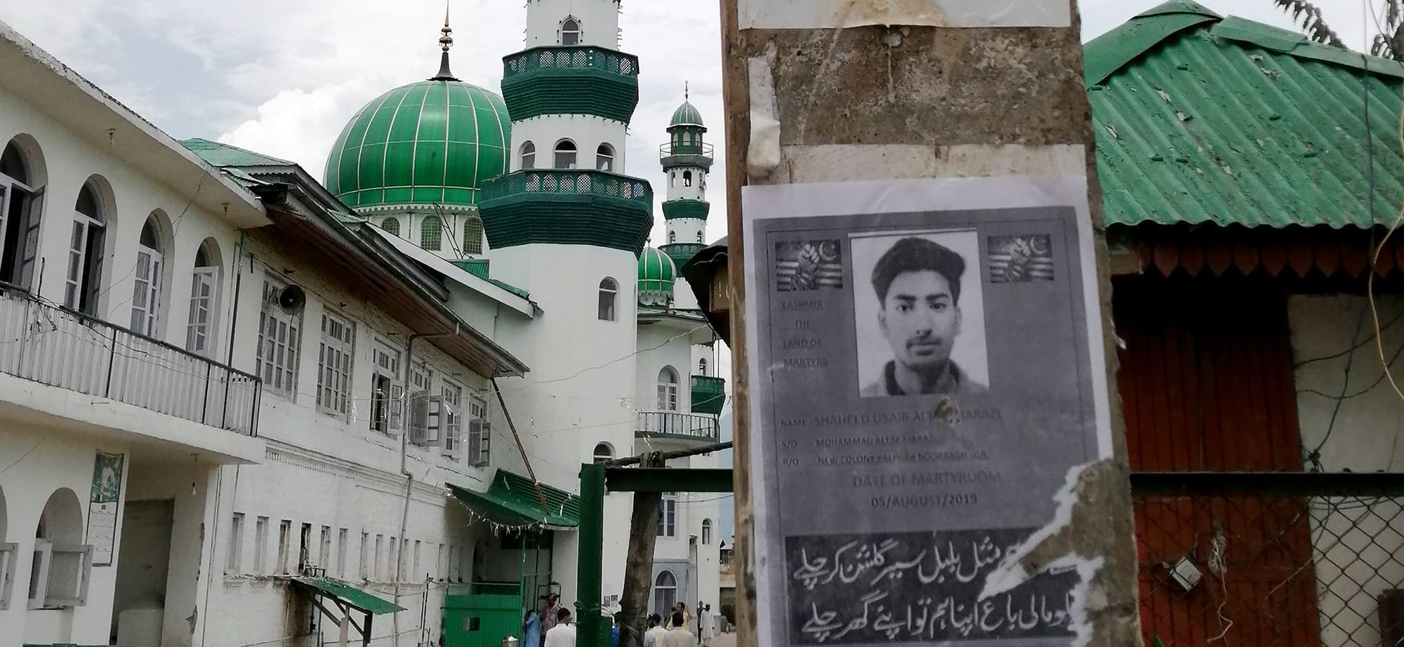 This picture taken on August 16, 2019, shows a poster of Kashmiri youth Usiab Ahmad, who died from drowning on August 5 after an alleged encounter with Indian government forces, near the Asar Shareef Jenab Saheb Mosque in the Soura locality of Srinagar. - Three deaths have been claimed by Kashmiri familes in the latest round of unrest in the region, but Indian authorities have not acknowledged any fatalities since the massive security and communications lockdown was imposed on August 5 following the decision to strip the region of its autonomy. (Photo by Jalees ANDRABI / AFP) / To go with 'IND