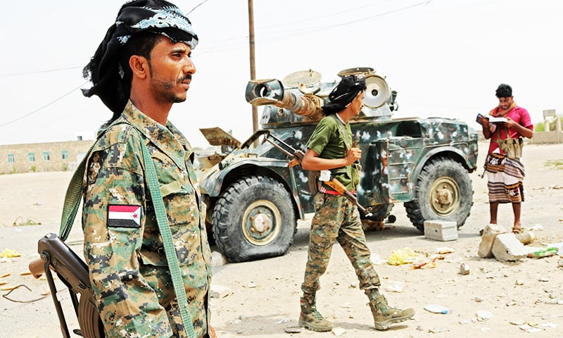 Fighters with the UAE-trained Security Belt Forces loyal to the pro-independence Southern Transitional Council (STC), gather near the south-central coastal city of Zinjibar in south-central Yemen. —AFP