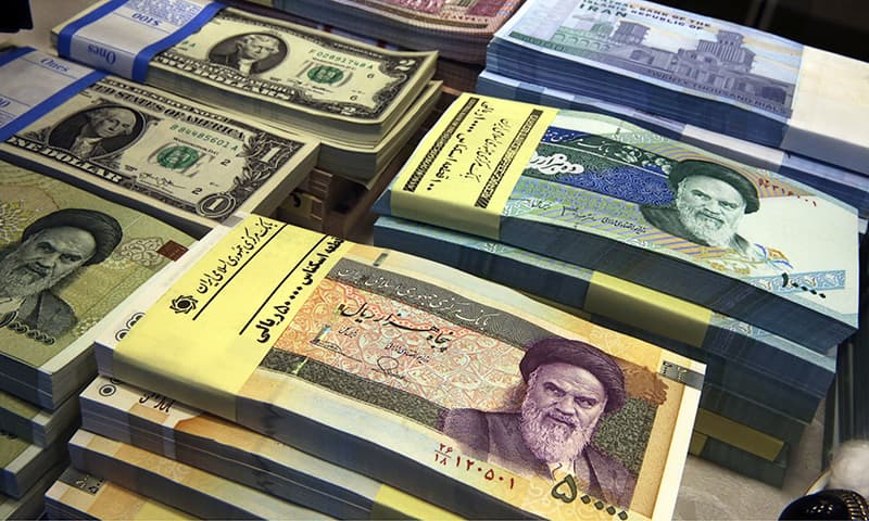 In this April 4, 2015 file photo, Iranian and US banknotes are on display at a currency exchange shop in downtown Tehran, Iran. — AP