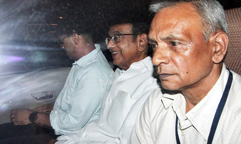 India's former finance minister Palaniappan Chidambaram (C) sits in a vehicle after he was arrested by the Central Bureau of Investigation. — Reuters