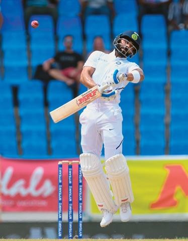 INDIAN skipper Virat Kohli sees off a bouncer during the first Test against West Indies at the Sir Vivian Richards Stadium on Thursday.—AFP