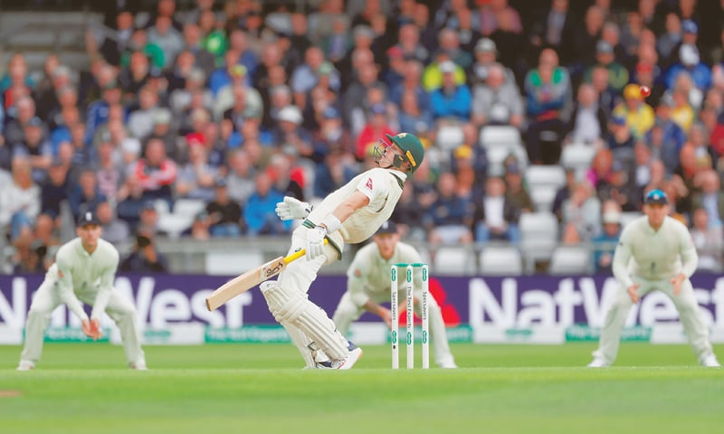 LEEDS: Australian batsman Marnus Labuschagne takes an evasive action during the third Ashes Test at Headingly on Thursday.—Reuters