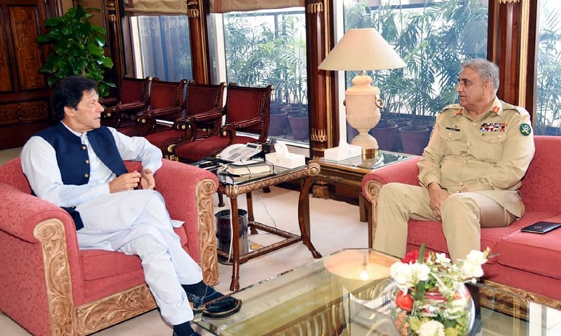 PRIME Minister Imran Khan exchanges views with Army Chief General Qamar Javed Bajwa during a meeting on Thursday.—PPI