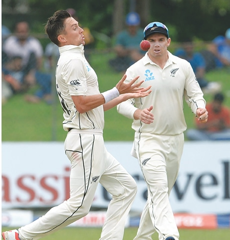 COLOMBO: New Zealand paceman Trent Boult drops a catch off Sri Lanka's Dhananjaya de Silva as team-mate Henry Nicholls looks on during the final Test  at the P. Sara Oval on Friday.—AFP