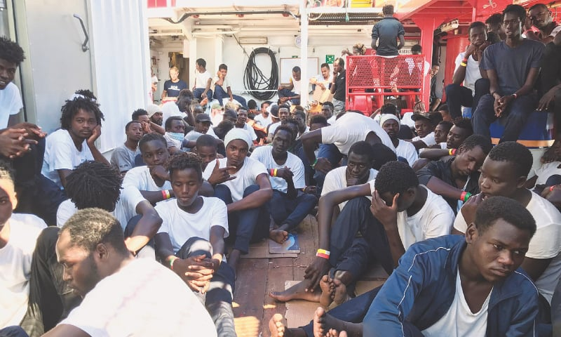 Rescued migrants gather aboard the Ocean Viking on Friday after the operation.—AFP