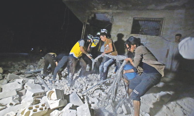 MAARET al NUMAN: Members of Syria's civil defence force sift through the rubble of a building following a government air strike  in  northwestern Idlib province.—AFP