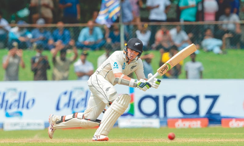 NEW ZEALAND opener Tom Latham in action durng his unbeaten century in the second Test against Sri Lanka at the P. Sara Oval on Saturday.—AFP
