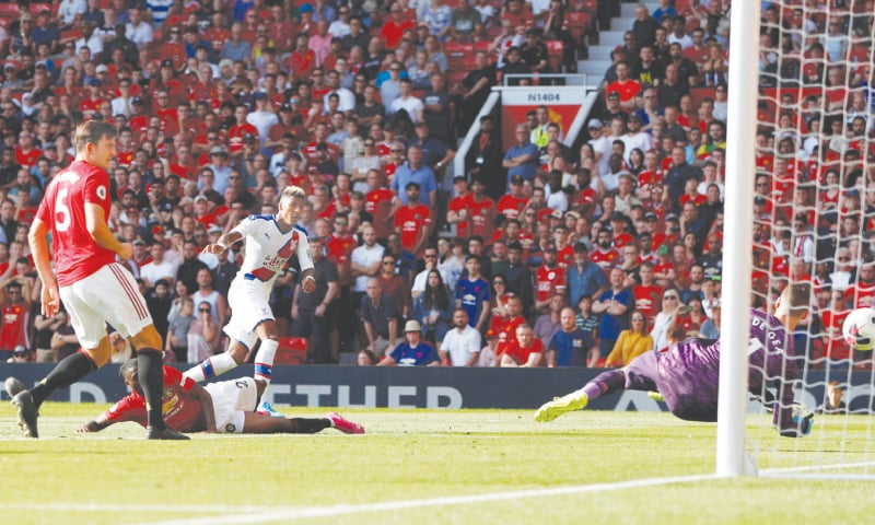 MANCHESTER: Crystal Palace's Patrick van Aanholt (white kit) scores their second goal against Manchester United at Old Trafford on Saturday. — Reuters