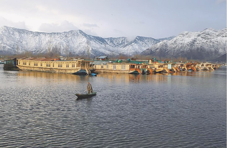 A Kashmiri man rows his boat in the waters of Dal Lake on a cold winter evening in Srinagar   Reuters/Danish Ismail