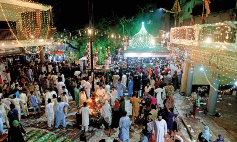 Devotees swarm the 400-year-old shrine of Hazrat Shah Chan Charagh on the occasion of Urs.