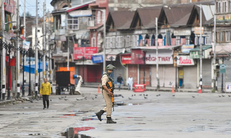 A security personnel patrols a deserted road of the Lal Chowk area in Srinagar in occupied Kashmir on August 19 | AFP