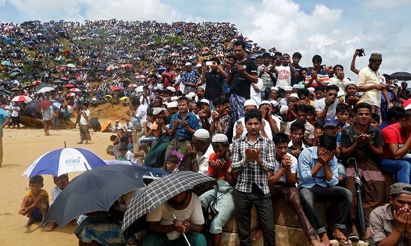 Rohingya refugees take part in a prayer as they gather to mark the second anniversary of the exodus at the Kutupalong camp in Cox's Bazar, Bangladesh on August 25. — Reuters