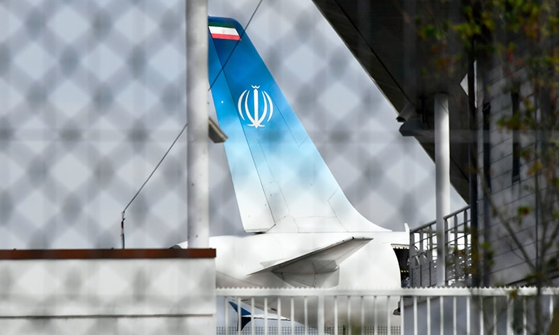 The airplane which carried Iran's Foreign Minister Mohammad Javad Zarif stands on the tarmac at the airport of the French seaside resort of Biarritz, south-west France, during the G7 summit in Biarritz, on Sunday, the second day of the annual summit. — AFP