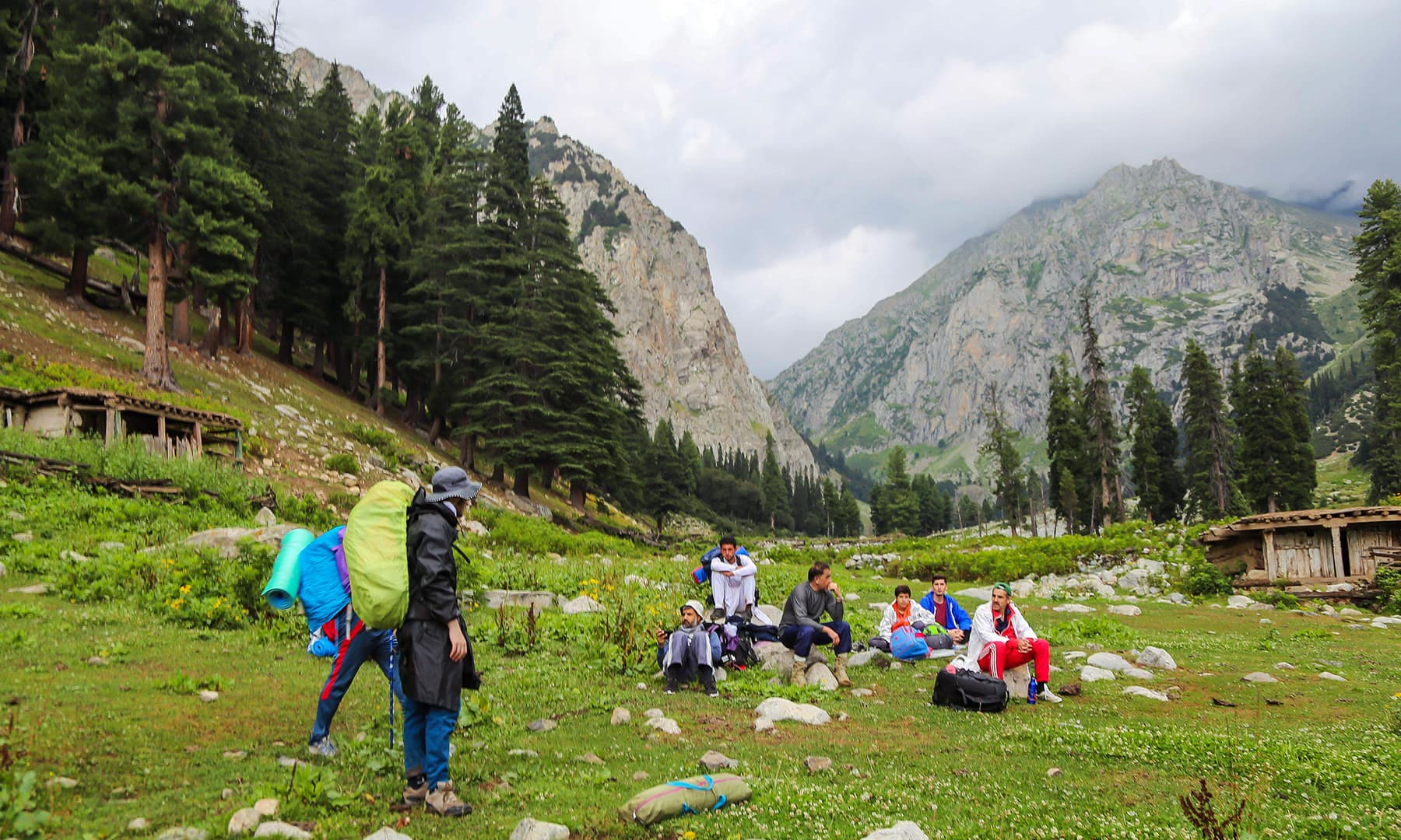 Trekkers and tourists are taking a break in Janshai meadows.