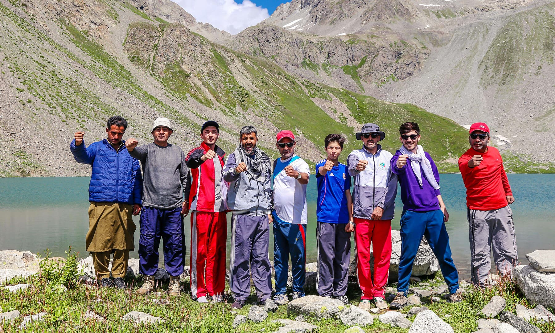 Jubilant trekkers pose for a photo after reaching Mastij Lake.