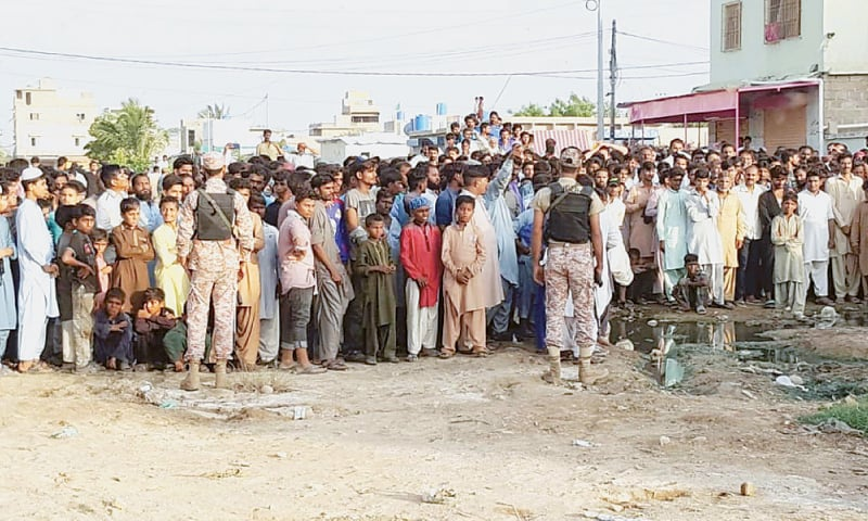 Officials came to Ahsanabad area on the outskirts of the city to remove encroachments from green belts. 1 Dawn/File