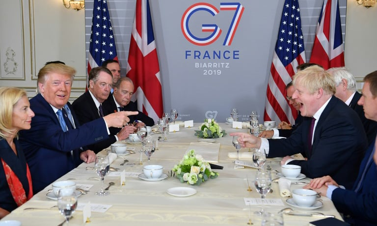 UK Prime Minister Boris Johnson and US President Donald Trump appeared to be on friendly terms as they sat down for a working breakfast. — AFP